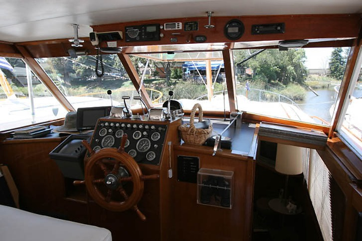 At the helm of Stephens Motoryacht