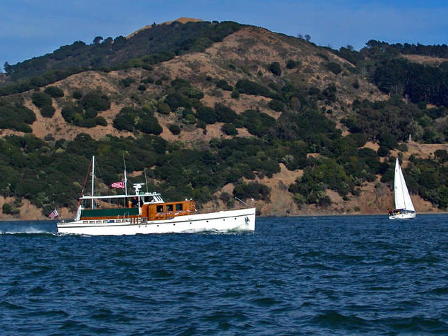 Classic Motoryacht In Front of Island
