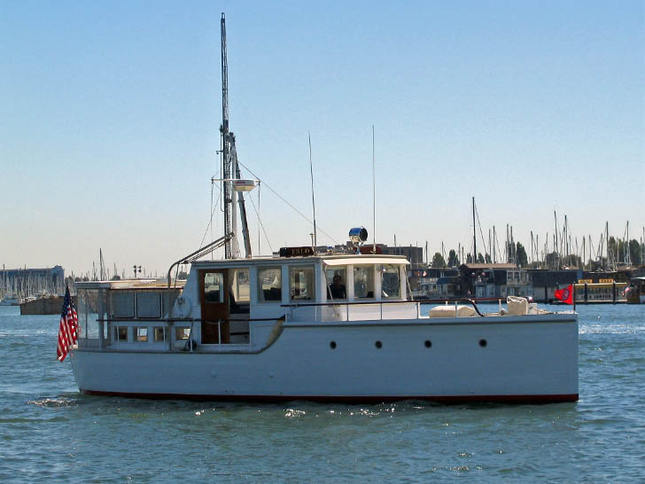 Classic Motoryacht Leaving Marina