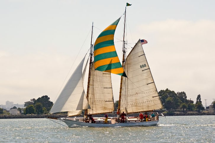 Large Sailboat with Green and Yellow Mast