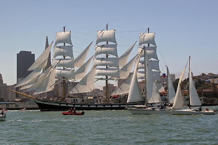 Tall ship Pallada sailing on San Francisco harbor