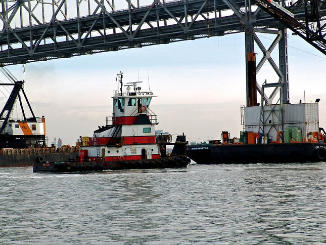 Tug at Work Under Bay Bridge