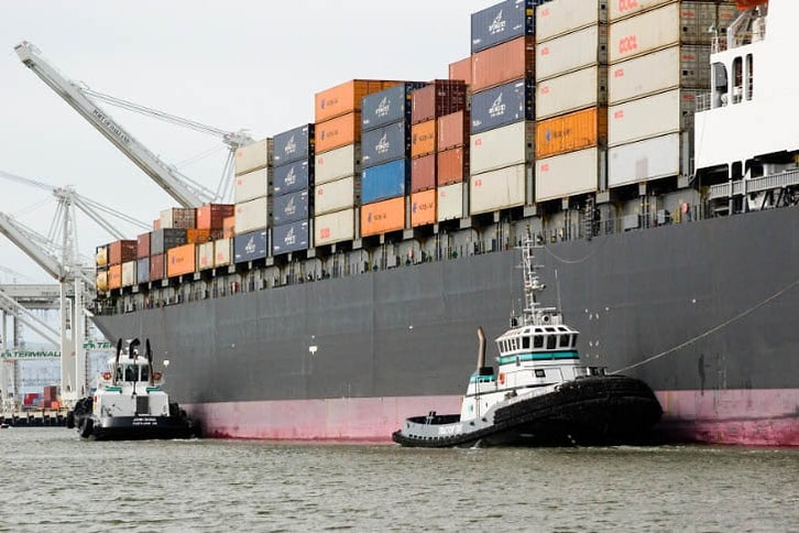 Tugs Docking a Containership